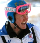 """Former Olympic ski jumper Eddie """"the Eagle"""" Edwards, from Britain, laughs after a ride from the 90 metre ski jump tower to commemorate the 20th anniversary start of the 1988 Olympics in Calgary, Alberta on Feb. 13, 2007. (THE CANADIAN PRESS/Larry MacDougal)"""