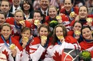 Team Canada celebrates with their gold medals Thursday, Feb. 25, 2010 after defeating the USA 2-0 in the women's gold medal final ice hockey at the 2010 Winter Olympic Games in Vancouver. THE CANADIAN PRESS/Jonathan Hayward