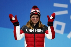 Women's 500 meters short track speed skating bronze medalist Kim Boutin, of Canada, gestures during the medals ceremony at the 2018 Olympic Winter Games in PyeongChang, South Korea, Wednesday, Feb. 14, 2018. (AP Photo/Patrick Semansky)
