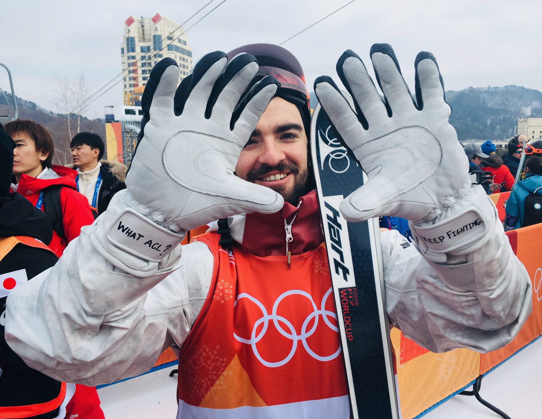 Skier holds up gloves to camera