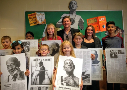 Students pose with Ray Lewis archives at the eponymous elementary school's library in Hamilton, Ontario. (Photo: Hamilton Spectator).