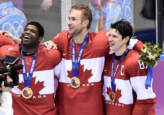 Team Canada players celebrate gold medal