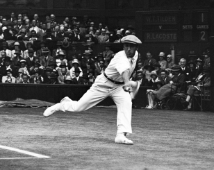 In this July 4, 1928 file photo, French tennis champion Rene Lacoste returns a shot, during the men's singles semi-final match against American Bill Tilden, on the Centre Court at the All England Lawn Tennis Championships in Wimbledon, London. (AP Photo, File)