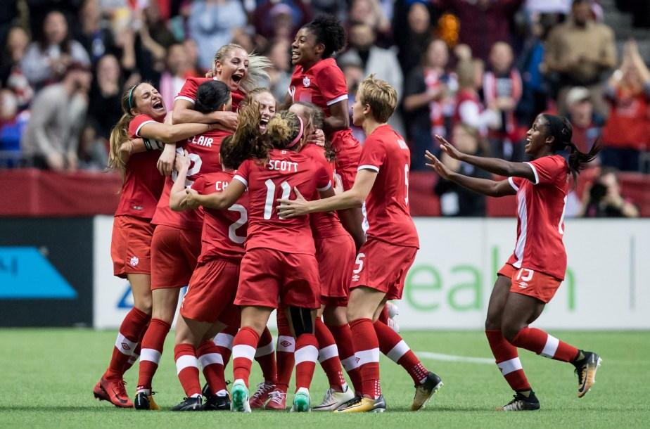 Women's soccer team celebrating