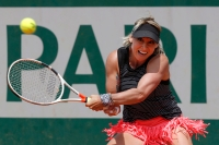 Bethanie Mattek-Sands of the U.S. returns the ball to Germany's Andrea Petkovic during their second round match of the French Open tennis tournament at the Roland Garros stadium, Thursday, May 31, 2018 in Paris. (AP Photo/Michel Euler)