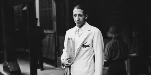 René Lacoste poses for the cameras at the 1929 French Open. (Photo: Esquire)