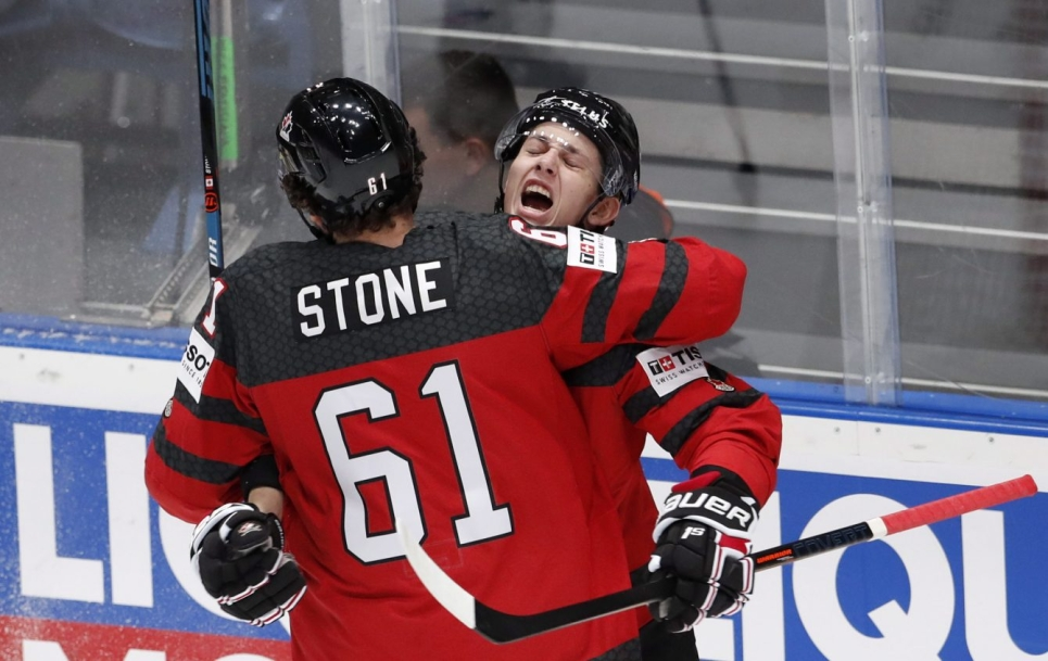 Mark Stone and Troy Stecher hugging after goal