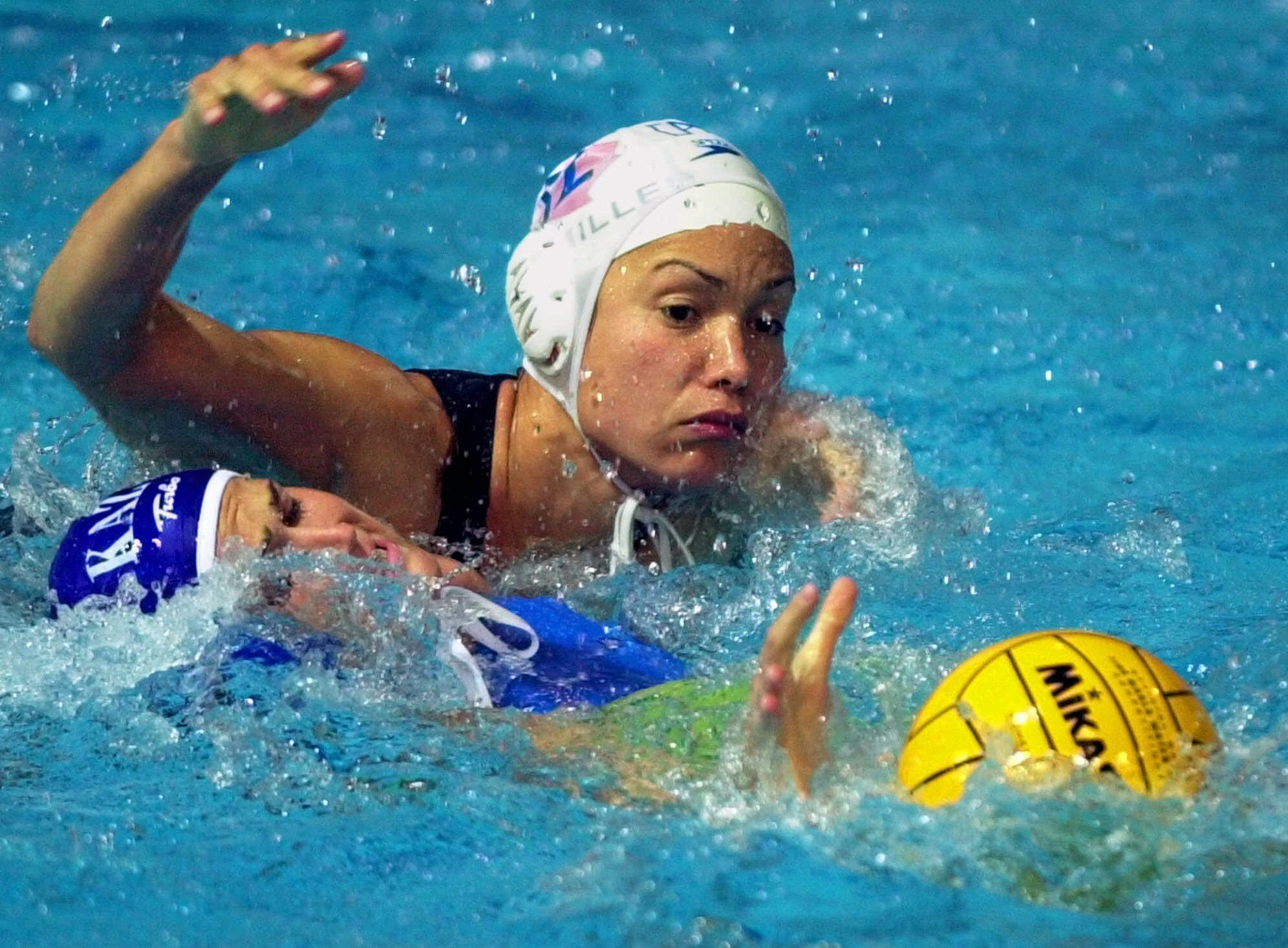 Waneek Horn-Miller reaches for the ball while battling defender