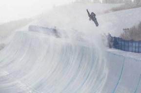 Braeden Adams in the air on his snowboard