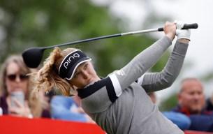 Brooke Henderson hits a tee shot