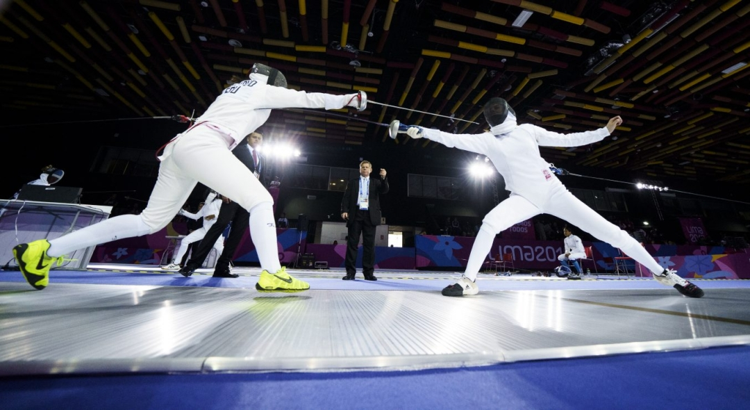 Shauna Biddulph, right, of Canada competes in womenÕs fencing