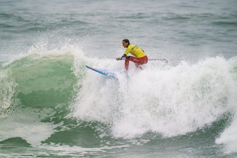 Catherine Bruhwiler rides a wave