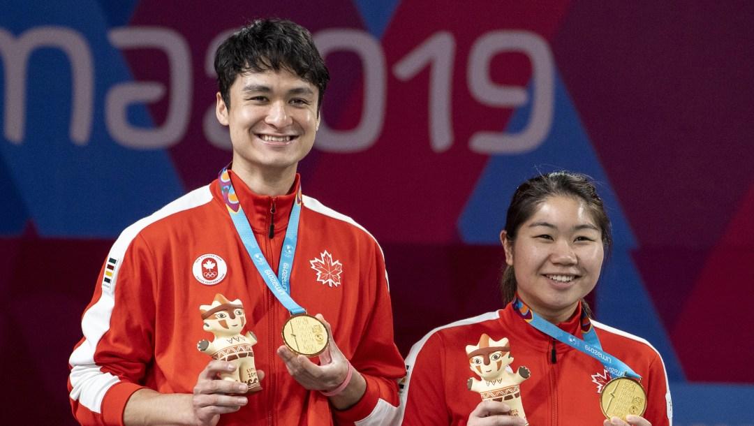 Joshua Hurlburt-Yu and Josephine Wu celebrate Mixed Badminton Gold at the 2019 Pan Am Games in Lima, Peru