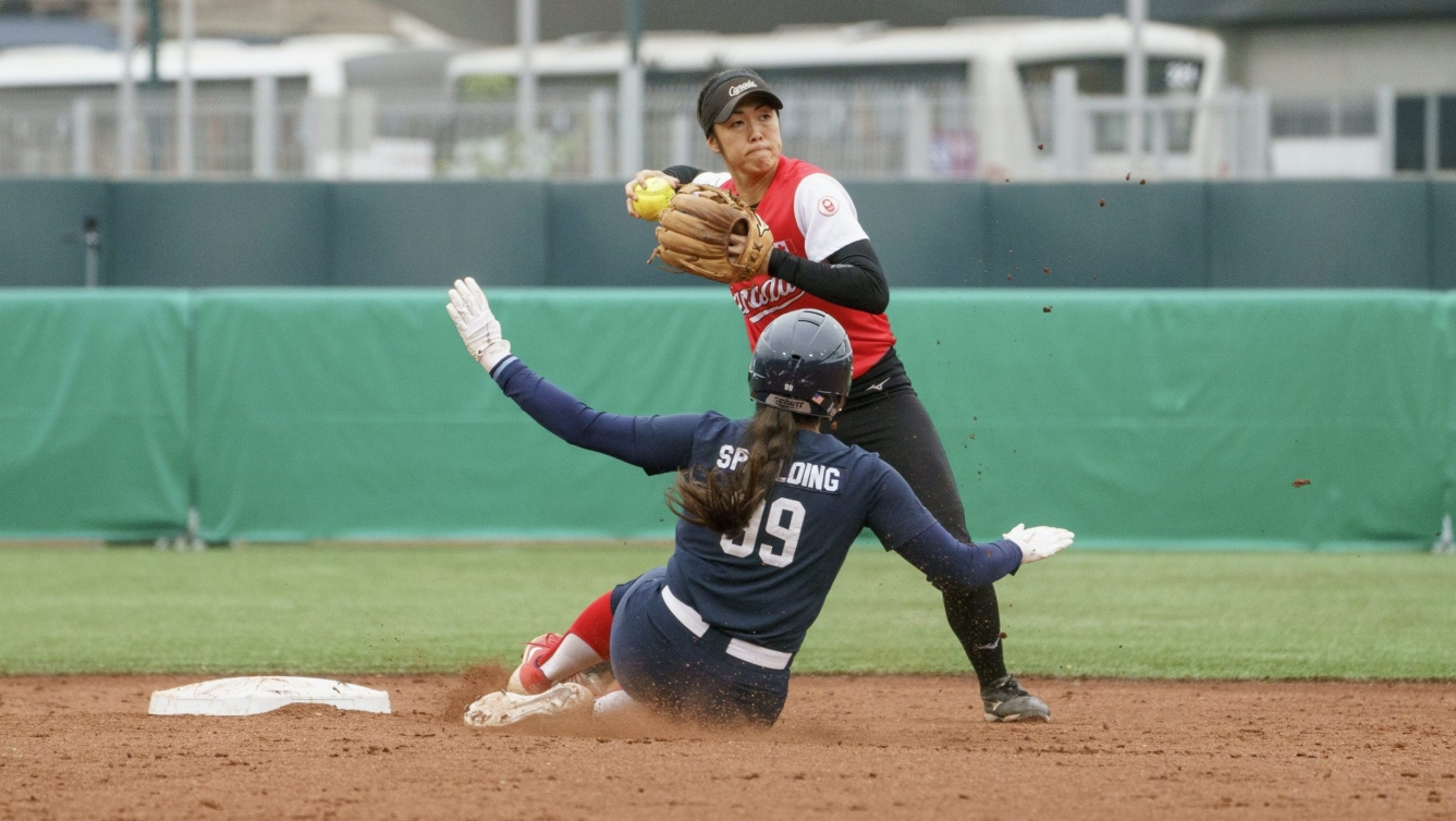 Janet Leung of Canada plays the ball against the United States in the women's softball final at the Lima 2019 Pan American Games