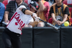 Canada's Jennifer Gilbert swings during fourth inning playoff action against Mexico at the Softball Americas Olympic Qualifier tournament