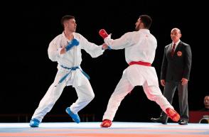Two karate athletes fighting