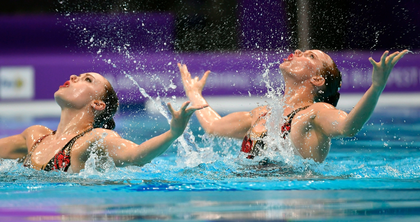 Claudia Holzner and Jacqueline Simoneau of Canada perform in the synchronized swimming duet