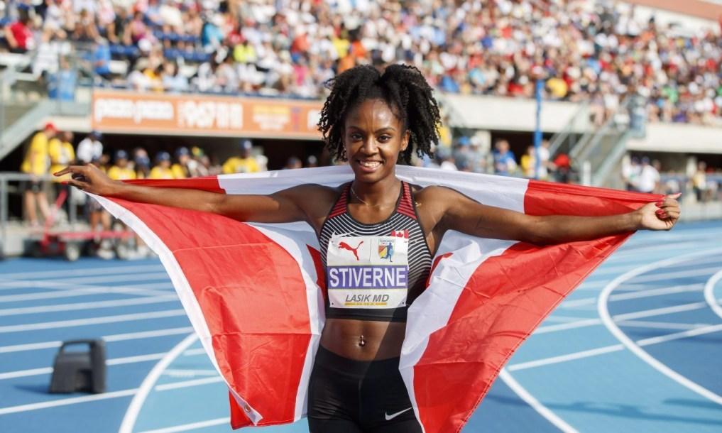 Aiyanna-Brigitte Stiverne celebrating with Canadian flag