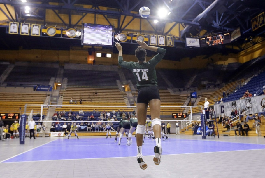 Volleyball player serving