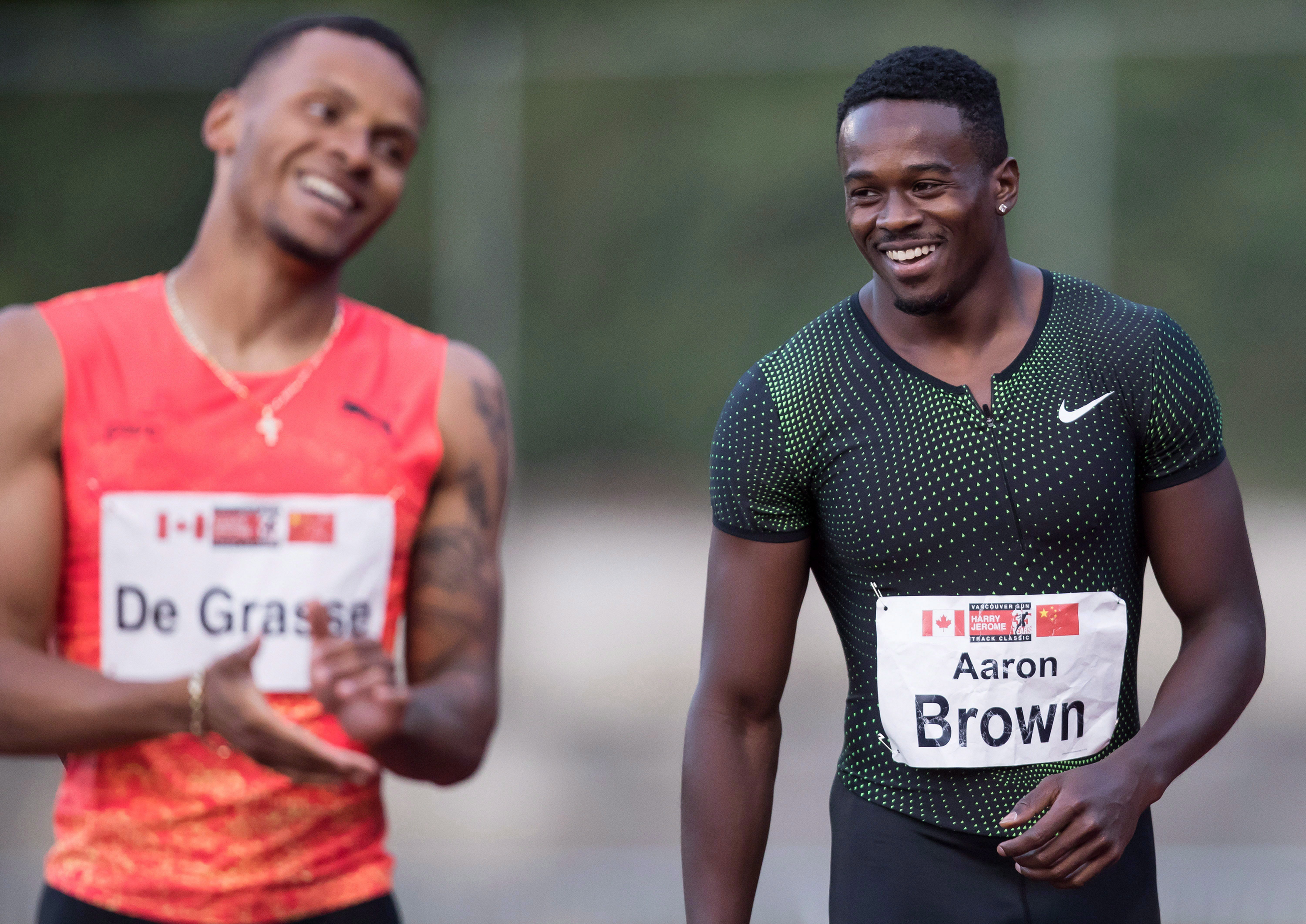 Aaron Brown and Andre De Grasse laugh together
