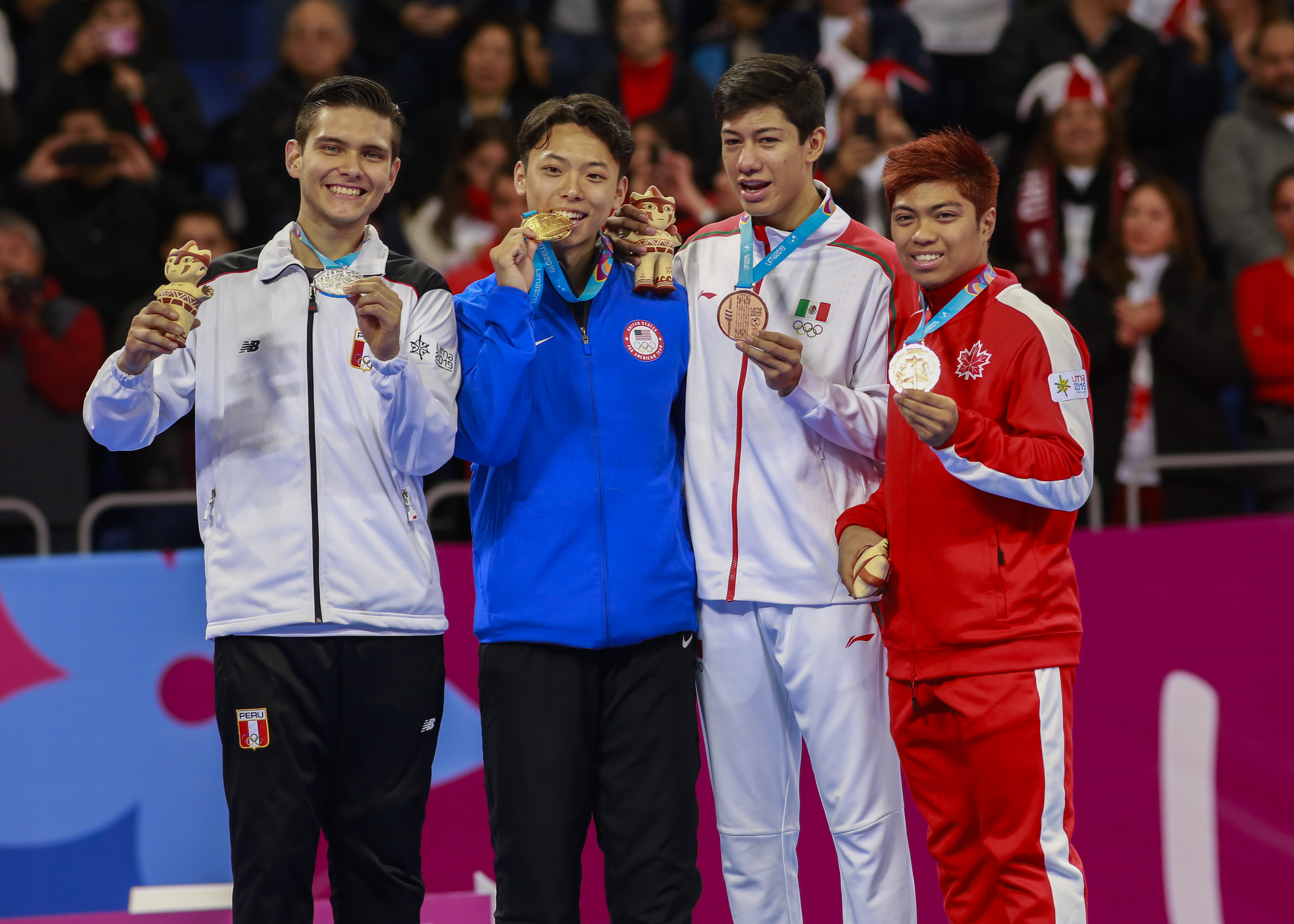 Hugo Castillo Peru ,left, holding the silver medal, Alex Lee from USA, the winner of the Taekwondo competition together with Marco Arroyo from Mexico and J. Abbas Assadian from Canada