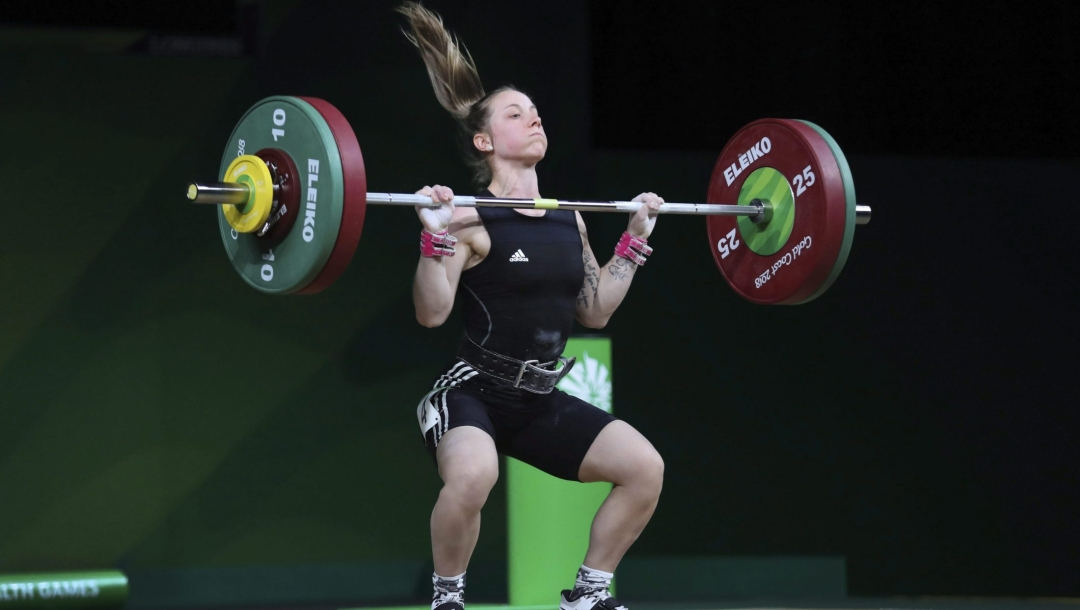 Female weightlifting in the middle of a lift