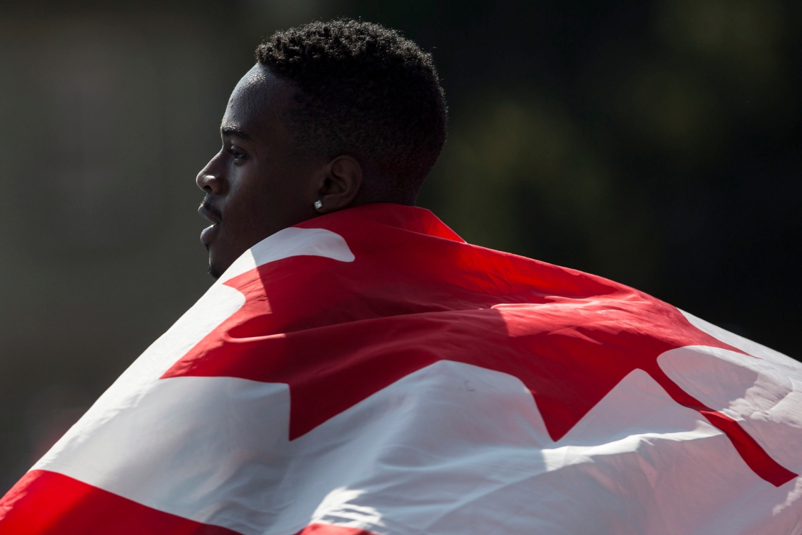 Aaron Brown with Canadian flag on his back