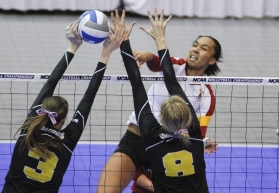 Alicia Ogoms spikes past two blockers