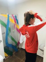 Athlete fixing her hair in bathroom