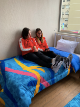 Athletes hanging out in their room at the village