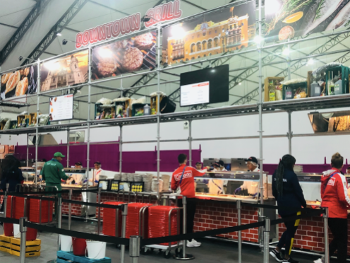 Athletes enjoying some food at the cafeteria in the athletes' village.
