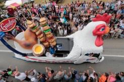Caravan passes through Tour de France as spectators watch