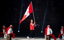 LIMA, Peru - Scott Tupper, flag bearer for Team Canada, enters the Estadio Nacional to officially start the Lima 2019 Pan American Games on July 26, 2019. Photo by Christopher Morris/COC