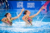 Claudia Holzner and Jacqueline Simoneau leaping out of the water