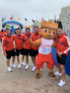 Athletes pose with mascot