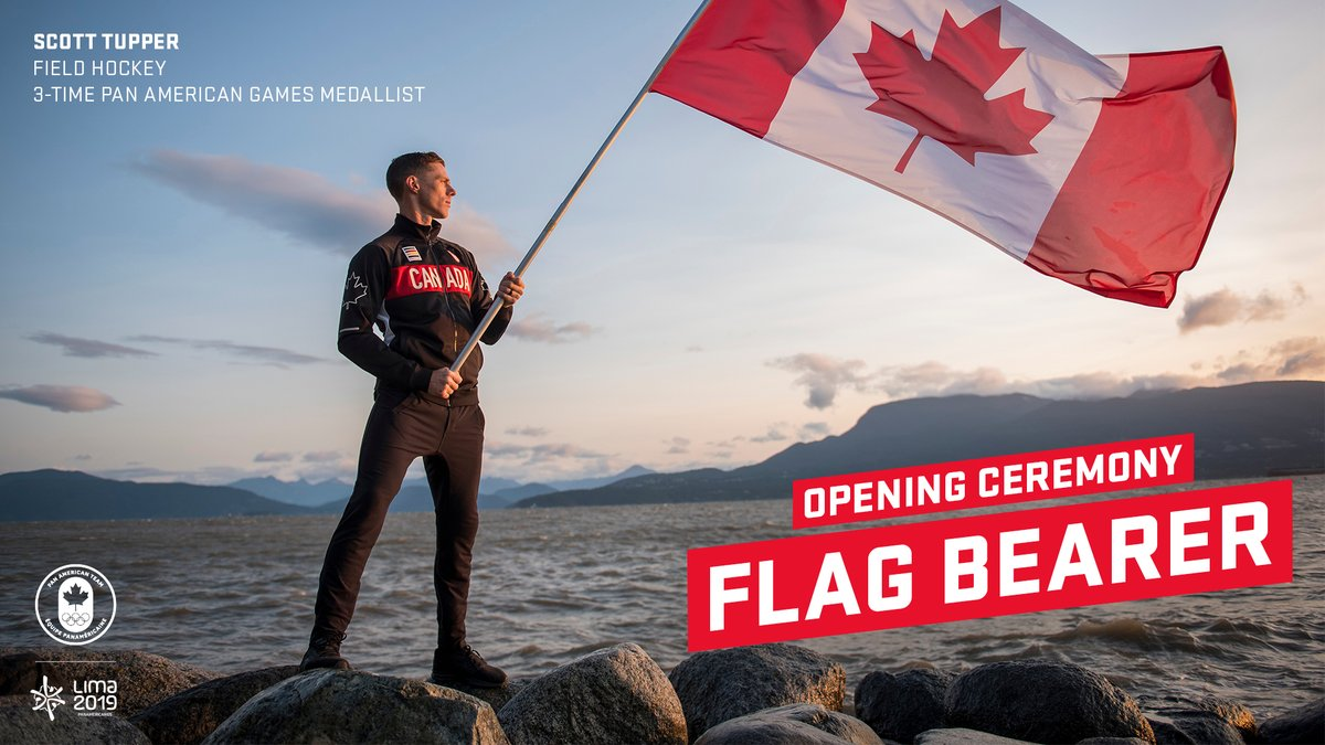 Graphic Scott Tupper holds a Canadian Flag