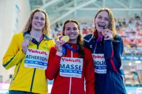 Minna Atherton, Kylie Masse, Olivia Smoliga, posing after the women's 100m backstroke final