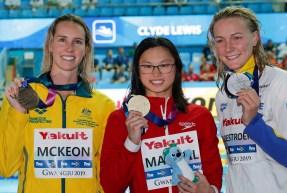 Gold medalist Canada's Margaret MacNeil, centre, stands with silver medalist Sweden's Sarah Sjostrom, right, and bronze medalist Australia's Emma McKeon
