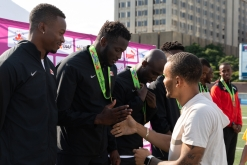Jerome Blake receives his medal for the 4x100m relay at the NACAC Championship in 2018.