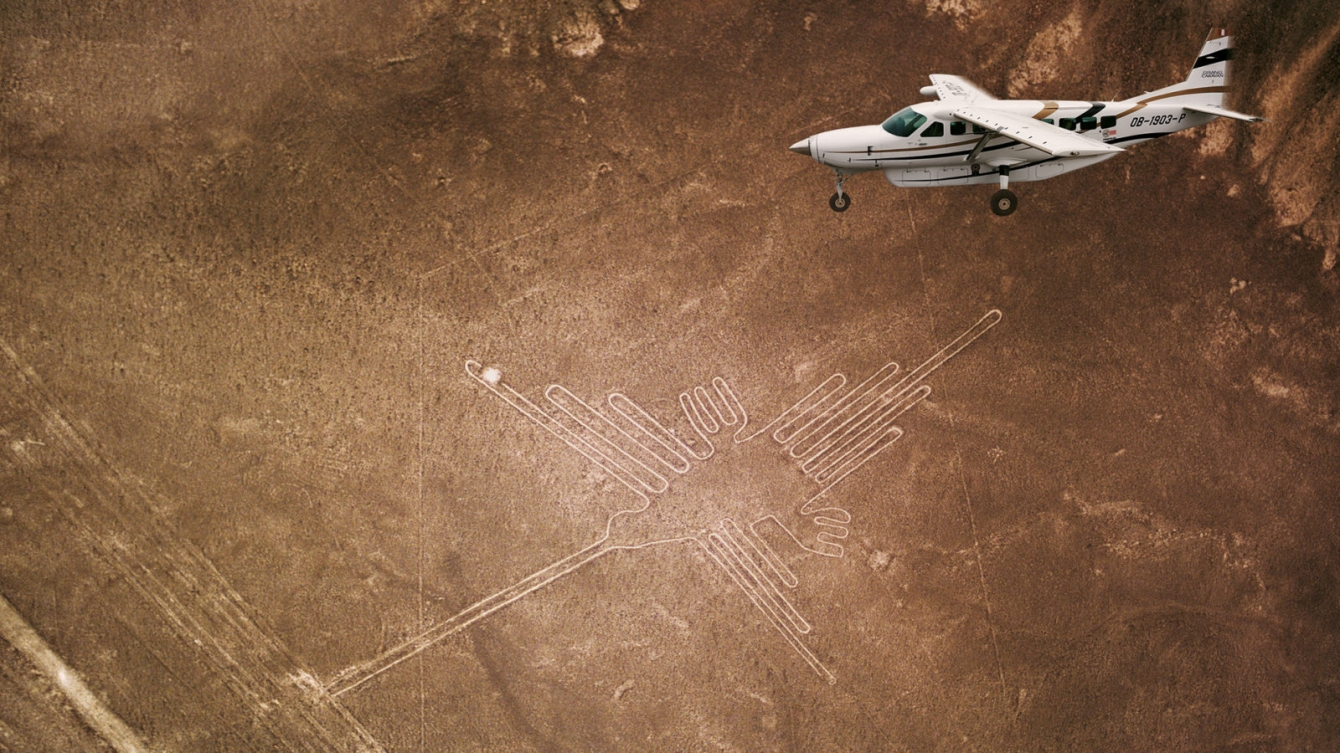 Airplane flying over Lines on the ground shaping a figure