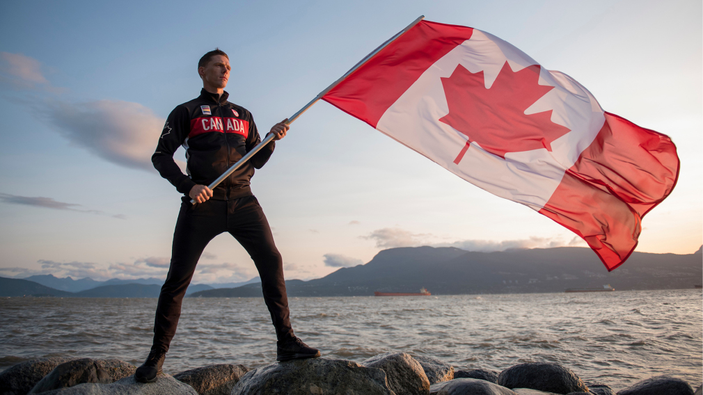 Scott Tupper holding Canadian flag