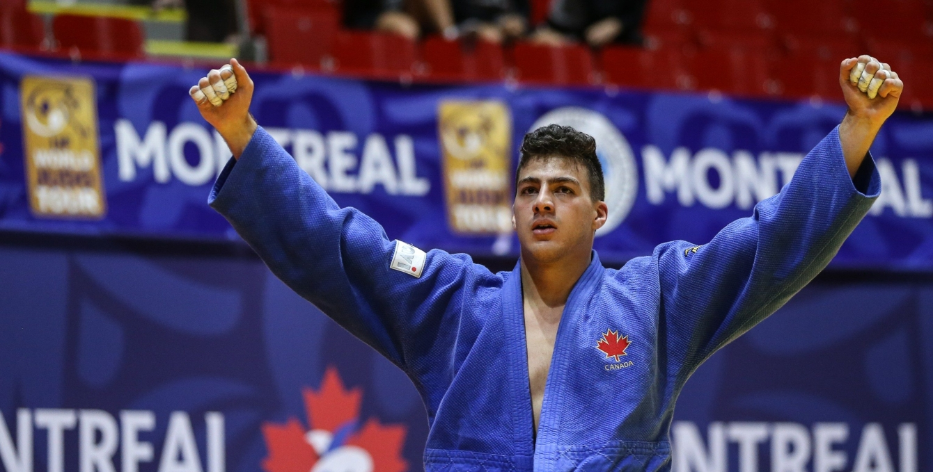Shady El Nahas raises his hands in celebration.