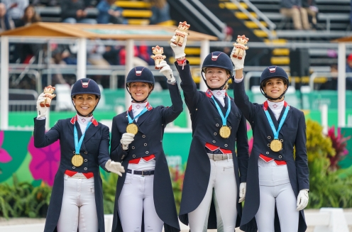 Four riders pose with their medals and Milko stuffed animals