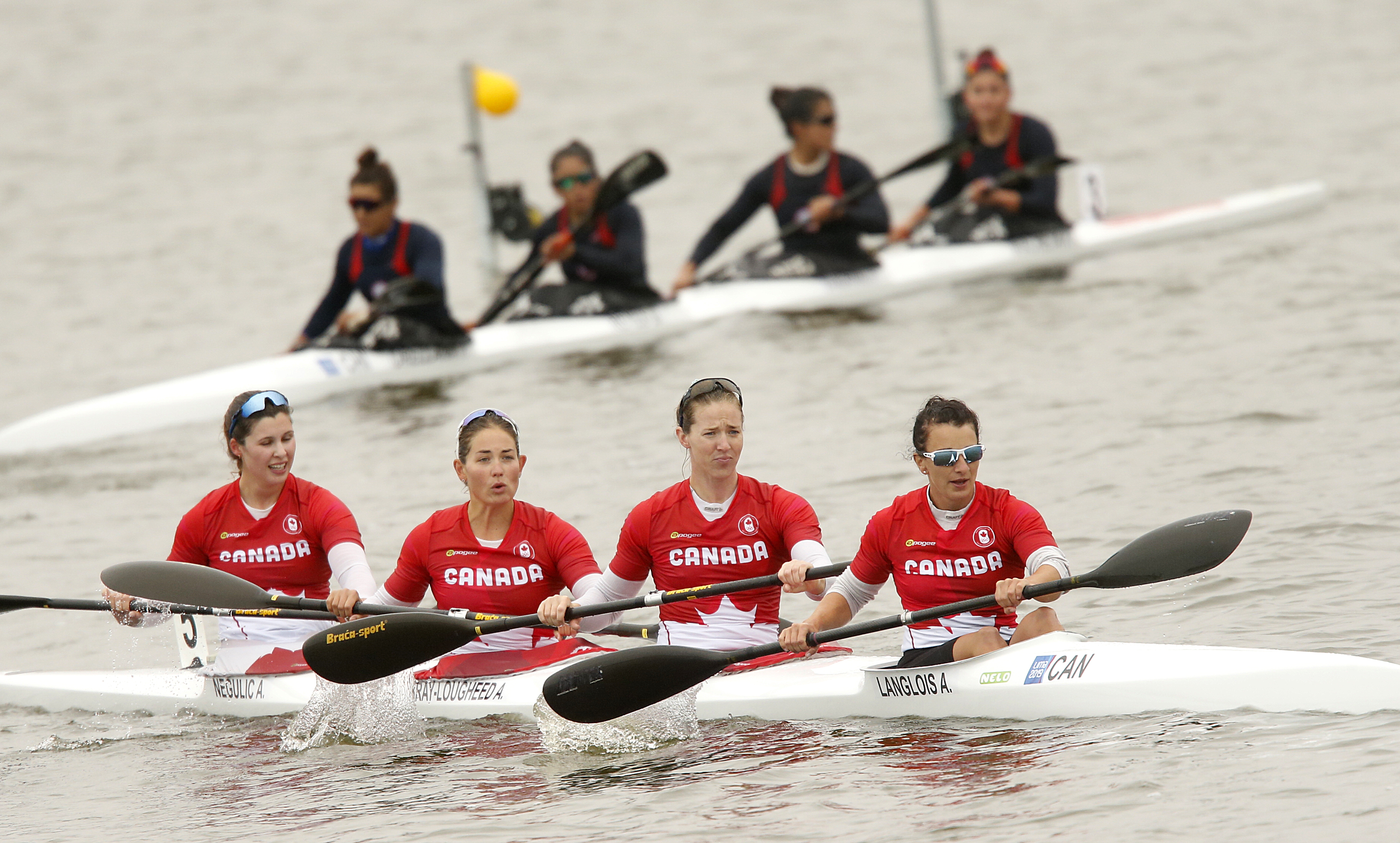 Canadian kayakers in boat on the water