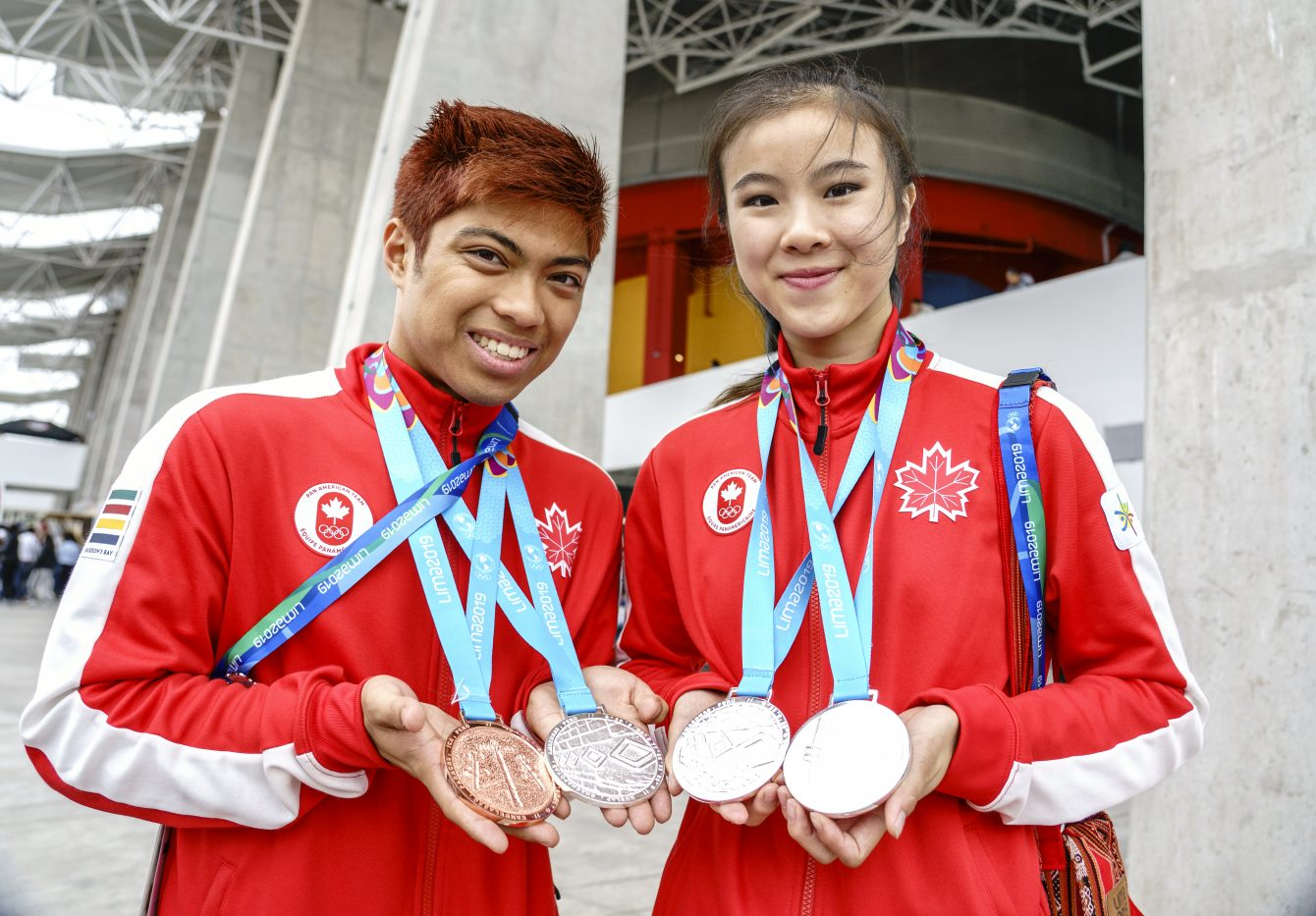 AJ Assadian (left) and Michelle Lee, pose for photos with their medals at Lima 2019.