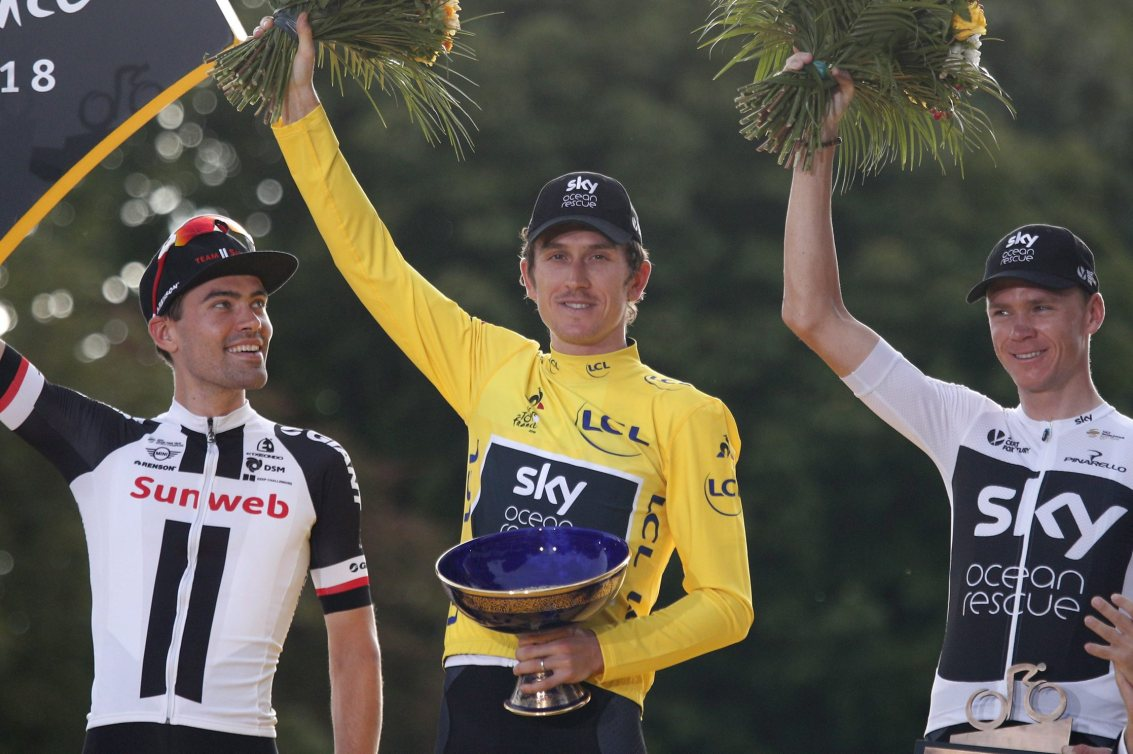 Tour de France winner Britain's Geraint Thomas, wearing the overall leader's yellow jersey, celebrates on the podium
