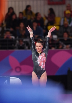 gymnast presents to the judges