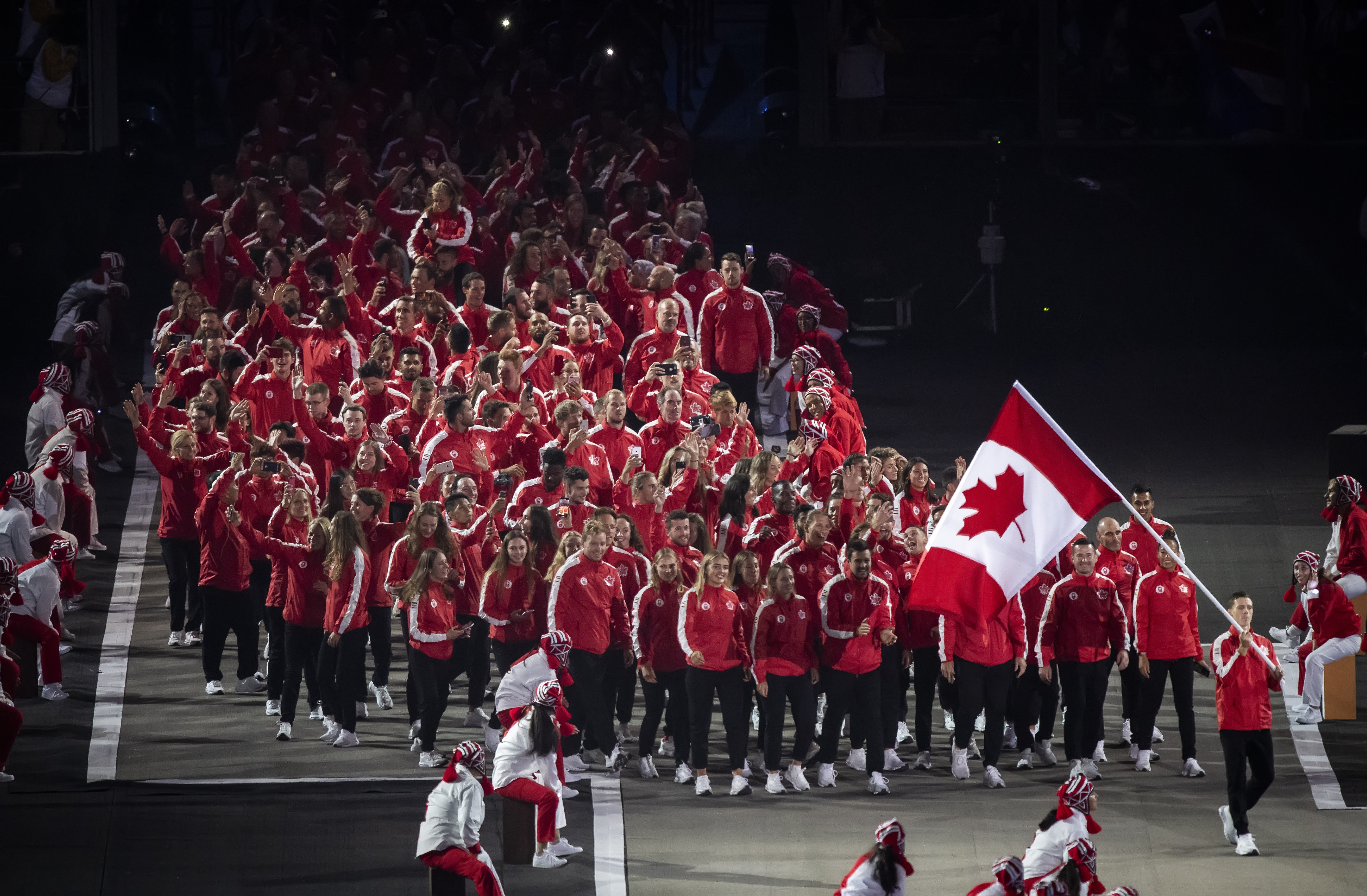 Scott Tupper leads Team Canada into the Opening Ceremony of the Lima 2019 Pan Am Games.
