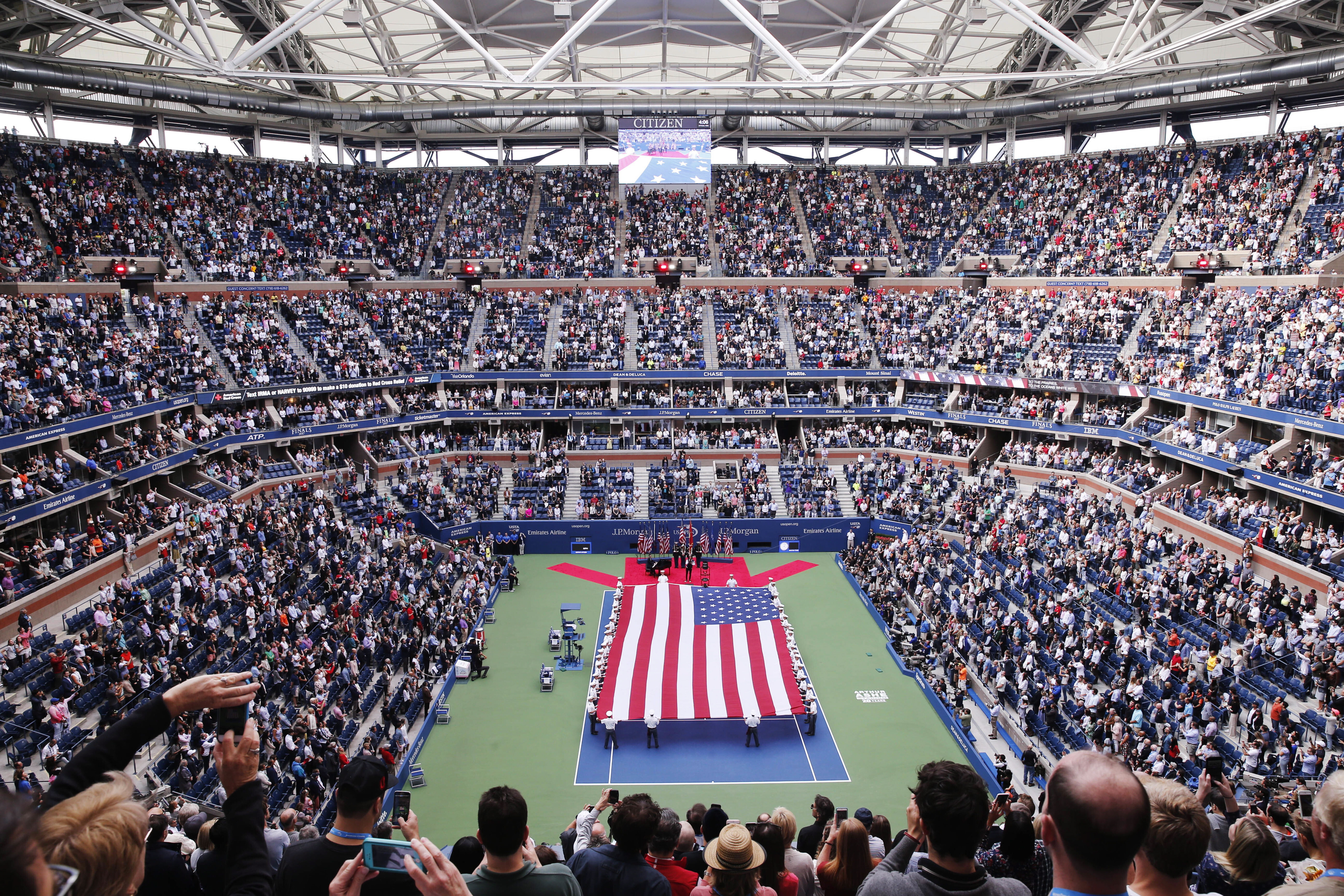 Aerial view of a tennis stadium with big USA flag