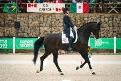 Anima Moreira rides past go Canada sign
